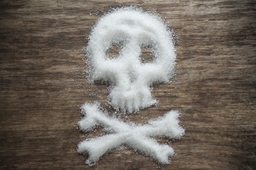 unhealthy white sugar on wooden background concept